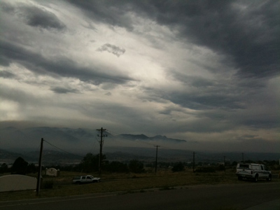 The actual scene was brighter than this, but the smoke blanketed the mountains.