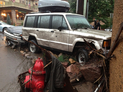 Vehicles crashed into the spa building's parking garage at Canon and Park avenues. Cliff House in background.