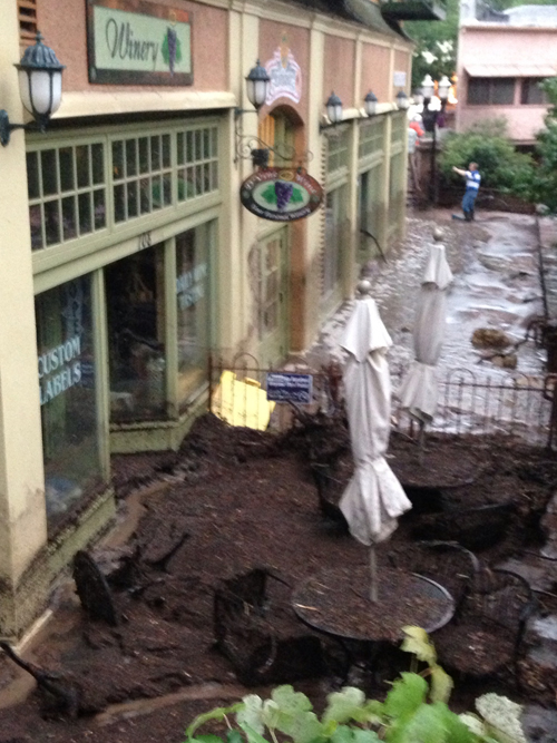 Water line on Adam's Mountain Cafe, and mud in front of D'Vine Wines.