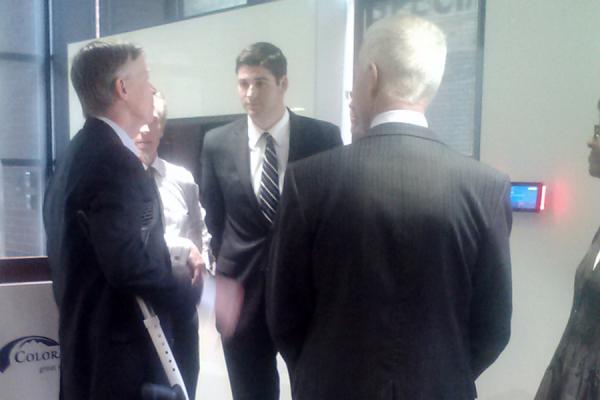 Governor John Hickenlooper meets with members of the business group Colorado Succeeds, which has endorsed the measure.
