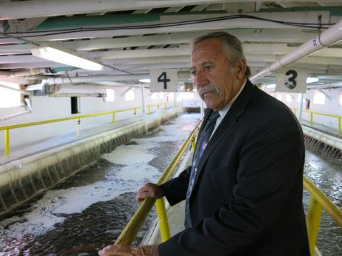 Steve Smith, director of Colorado Correctional Industries, tours an on-prison greenhouse that houses a tilapia farm.