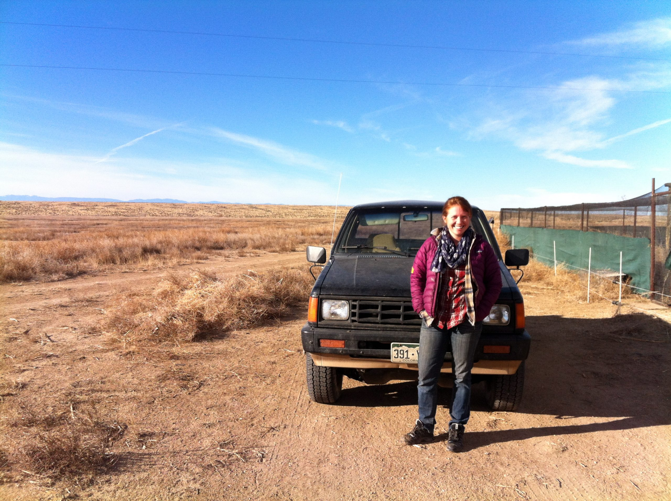 Education Director Kathryn Baker poses in front of one of the Ranch's many trucks