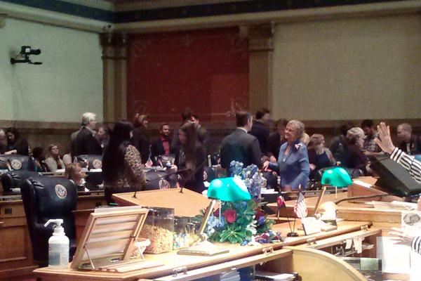 Lawmakers get reacquainted before the new legislative session opened at the Colorado capitol Wednesday, Jan. 8, 2014.