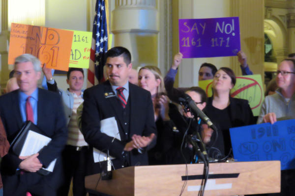 Opponents of two religious liberty proposals rally at the state capitol prior to the hearing on Monday. They said the bills would hurt business and give people a license to discriminate in Colorado. Jessie Ulibarri (D-Westiminster) attended the rally.