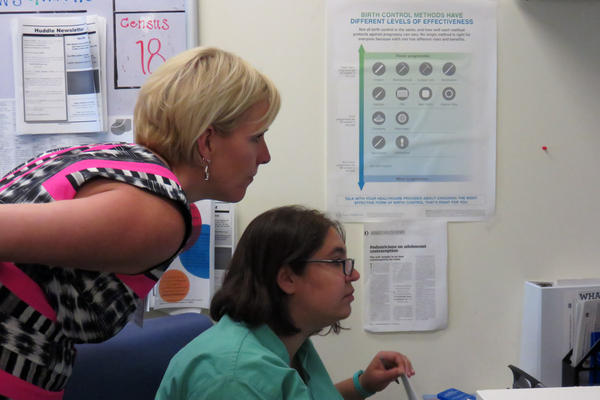 Liz Romer, a nurse practioner and director of the family planning program for Children's Hospital Colorado looks over a list of patient appointments with Rebecca Cohen M.D.