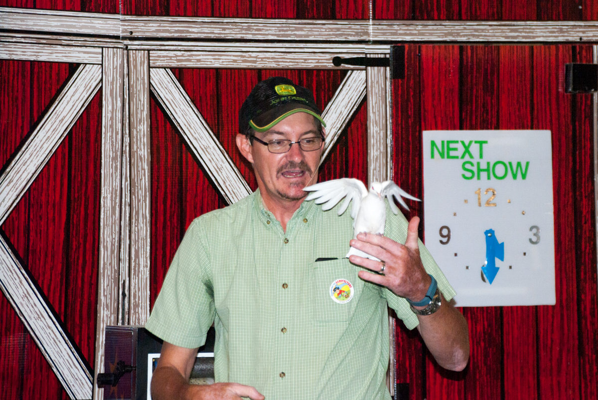 Magician Kyle Groves conjures up a bird as part of his act - Stirrup Some Fun - that teaches kids about agriculture.