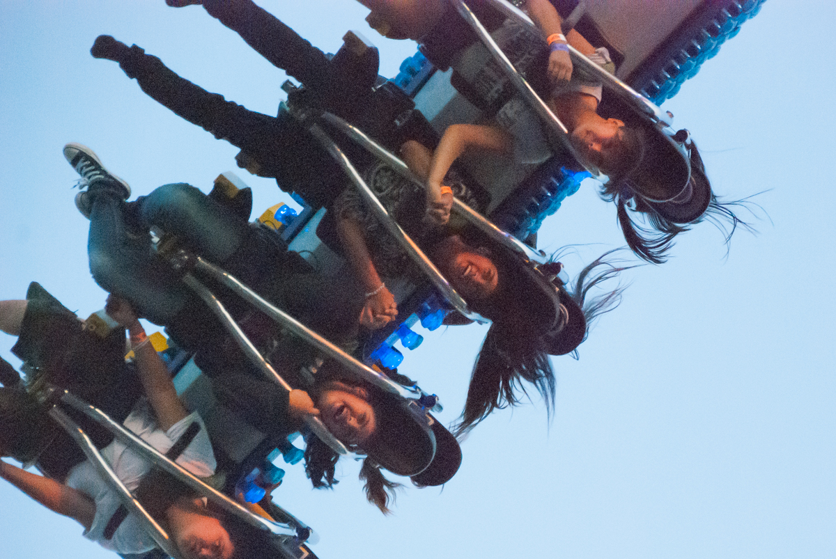 Fairgoers spin and scream on the Sky Trip ride at the Colorado State Fair.