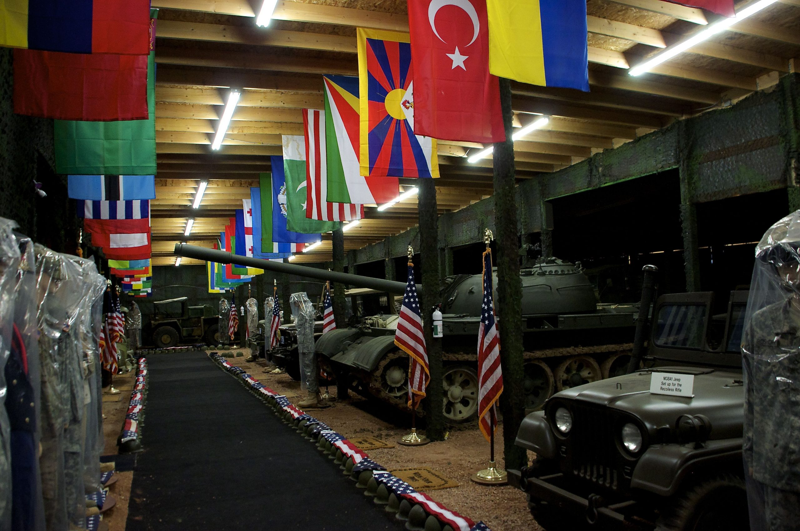Flag room with vehicles and tank