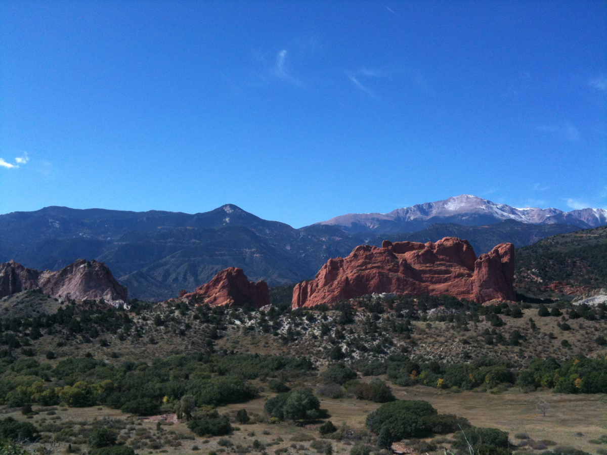 The 'Ring the Peak' trail project that seeks to complete a trail loop around Pikes Peak (seen here with Garden of the Gods) is among the 16 priorities listed in Governor Hickenlooper's 'Colorado the Beautiful' initiative. Pikes Peak 2014