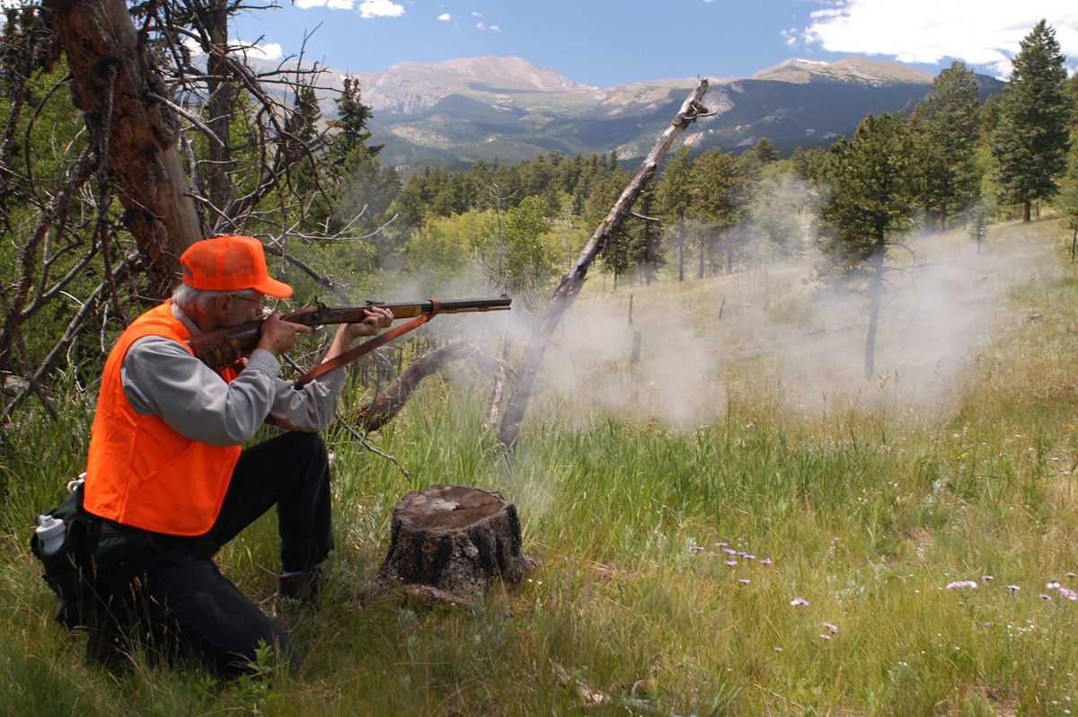 A hunter fires a Hawken muzzle-loading rifle.