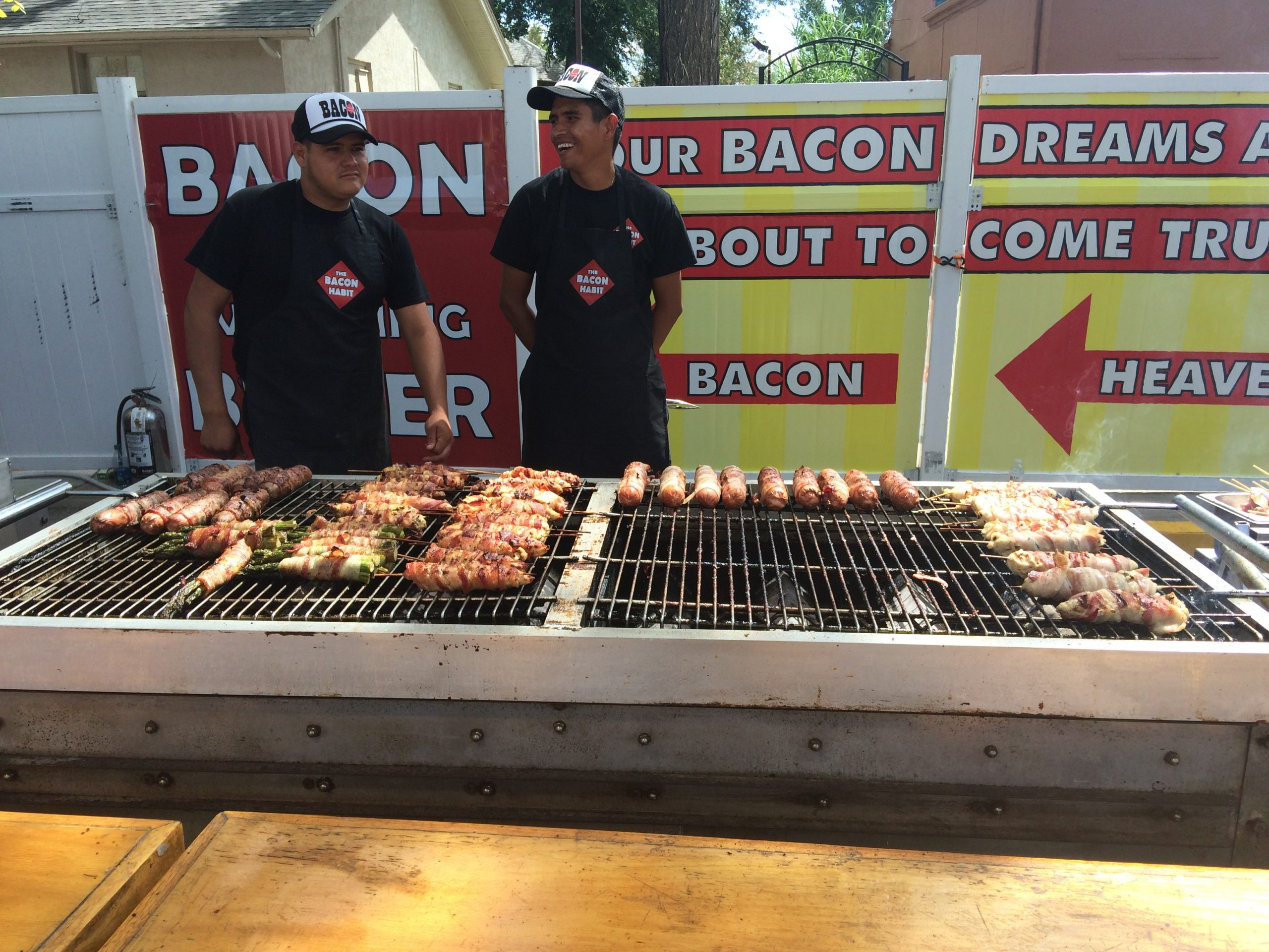 Vendors sell a variety of bacon-wrapped delicacies.