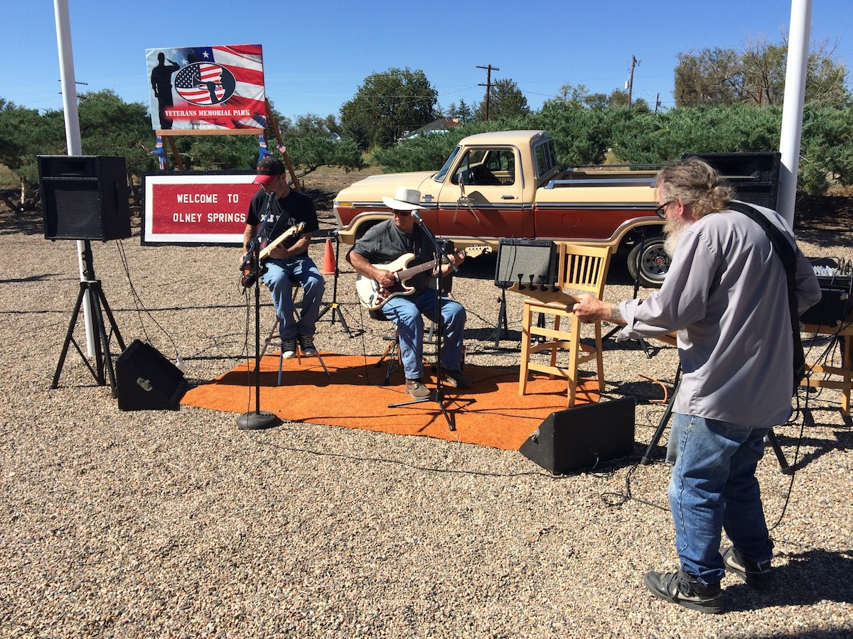 Mick Baker of Olney Springs, Kenny Nickolson of Pueblo, and Kenny Morgan of Manzanola perform at the Olney Springs War Memorial.