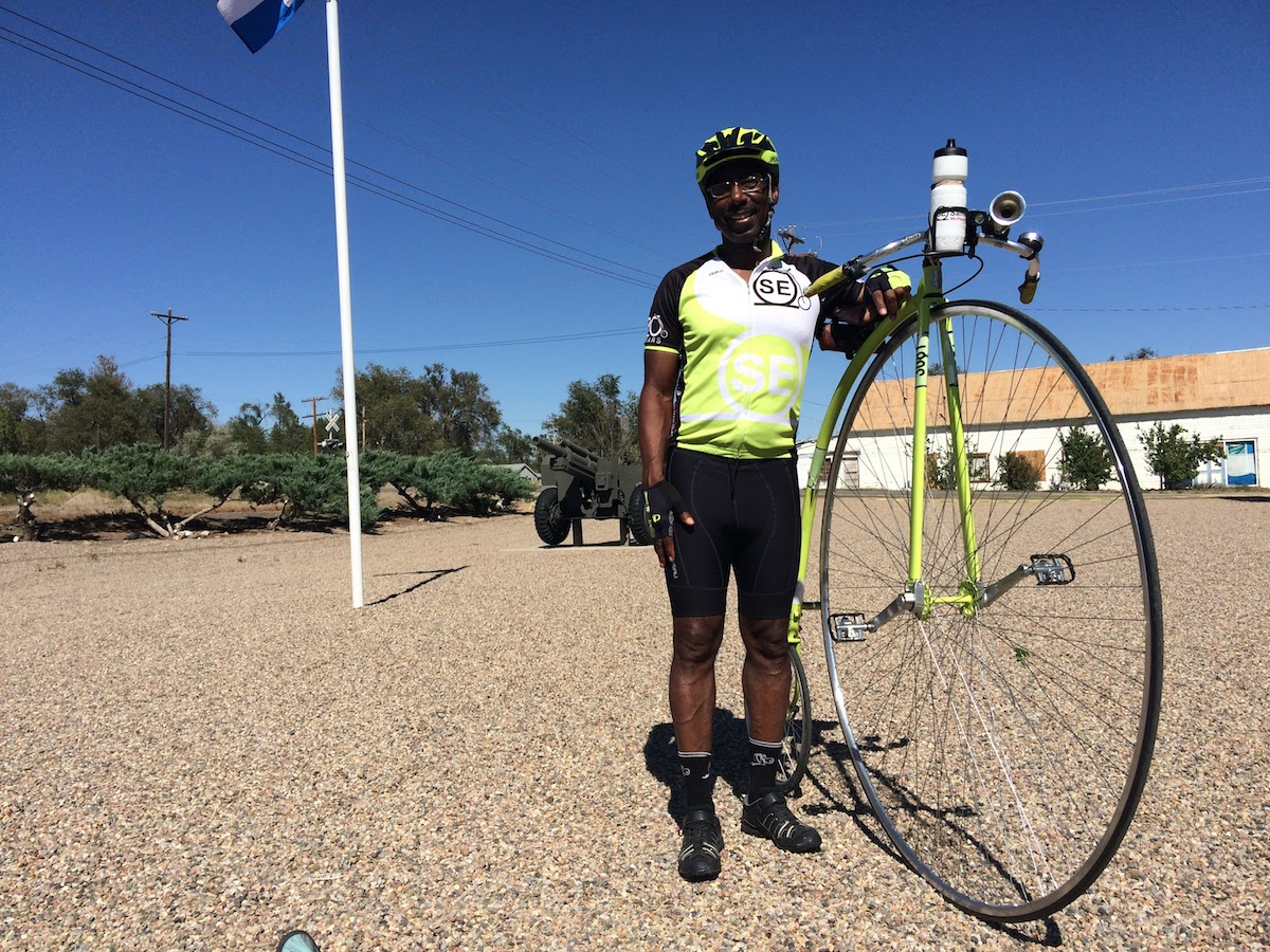 "Everod Samuel poses with his old fashioned ""penny farthing."""