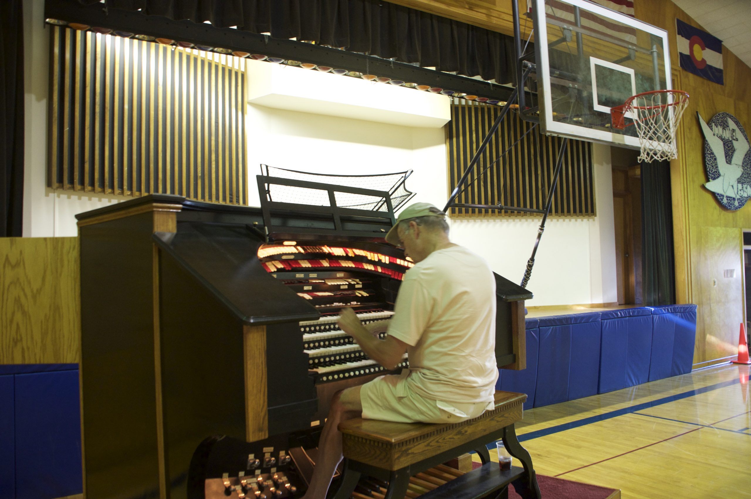 Dave Weesner playing the organ. The organ pipes live behind the white wall pictured here in the background.