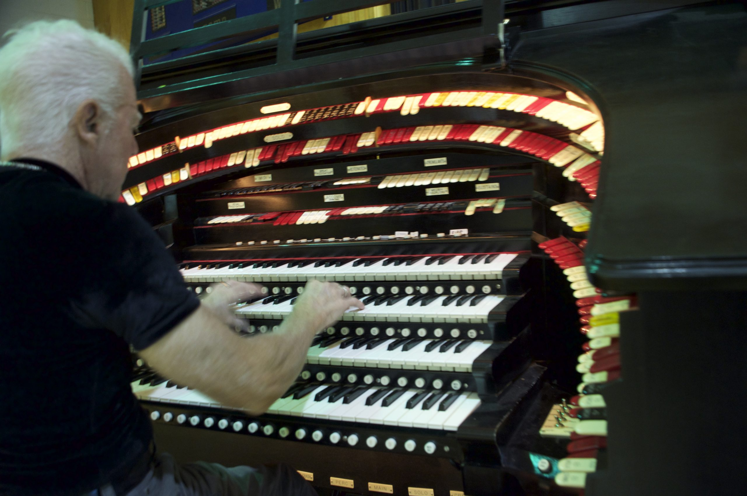 Pikes Peak Area Theater Organ Society member Keith Roberts takes a turn on the organ.
