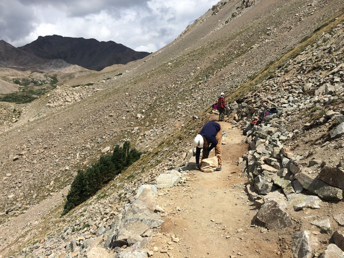 A CFI and youth corps crew work on a new trail on Mount Columbia. August 2016