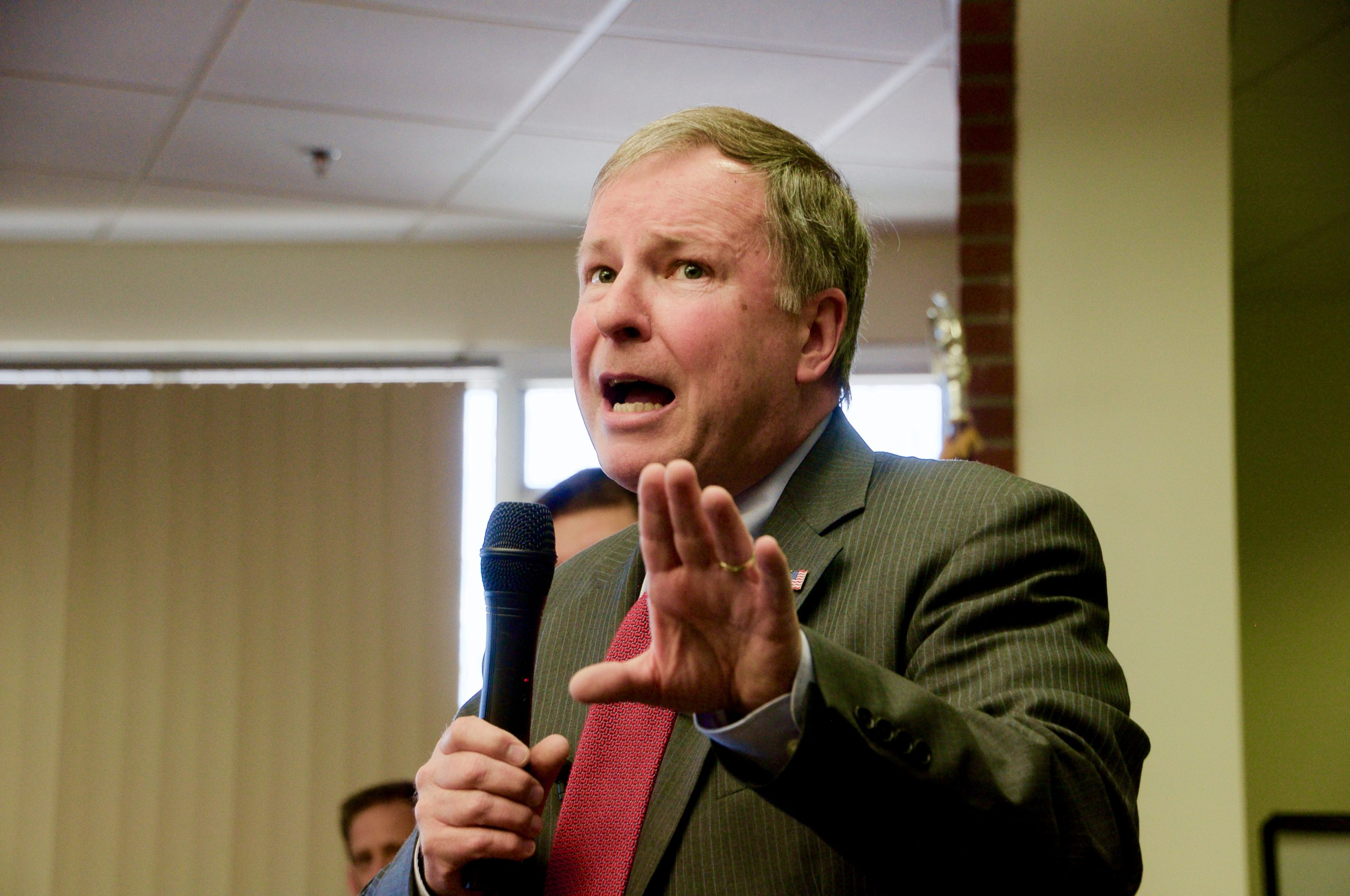 Congressman Doug Lamborn speaking to constituents at a town hall forum in Colorado Springs.