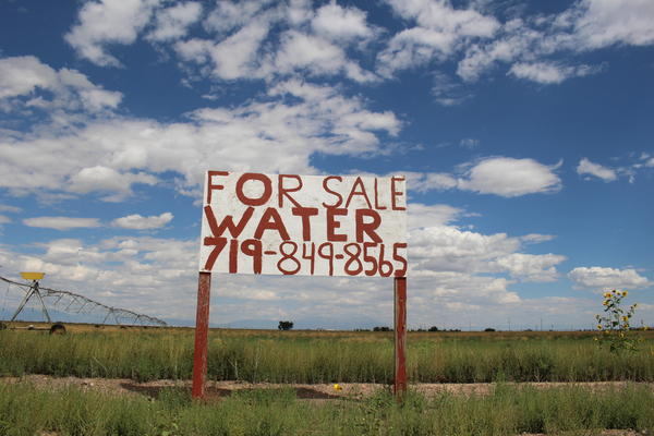 A sign advertising a water sale sits on a farm outside Del Norte, Colorado.
