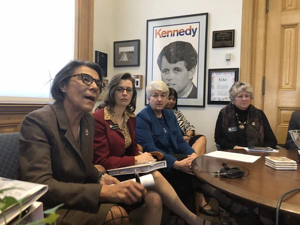 Sen. Lucia Guzman speaking with her caucus about sexual harassment at the capitol.