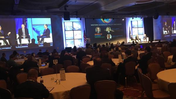The governors of Utah and Colorado, Republican Gary Herbert and Democrat John Hickenlooper, respectively, shared their thoughts about energy on stage at Herbert's annual Energy Summit on Tuesday. Their views differ on how well Washington is listening.