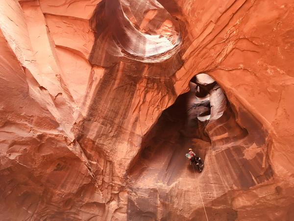 Canyoneers like Alessandro Franchin exit Neon Canyon through holes carved in the rock by years of water erosion.