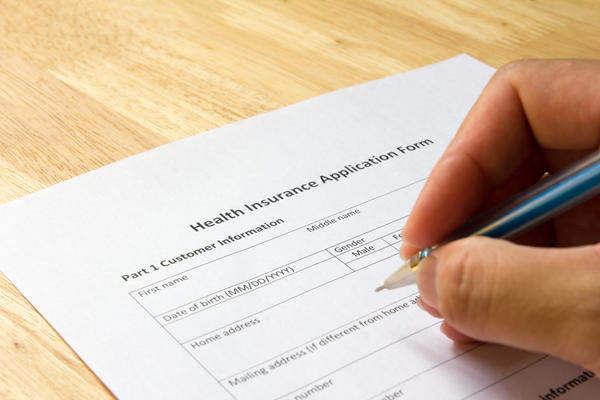 Man fill the health insurance application form