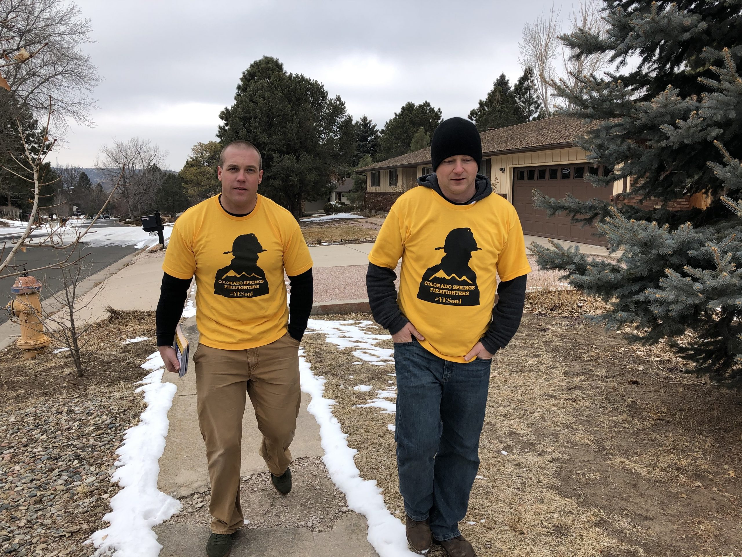 Jason Jones (left) and John Giacoma (right) canvass a Colorado Springs neighborhood in support of Issue 1, which would give Colorado Springs firefighters a collective bargaining agreement with the city.