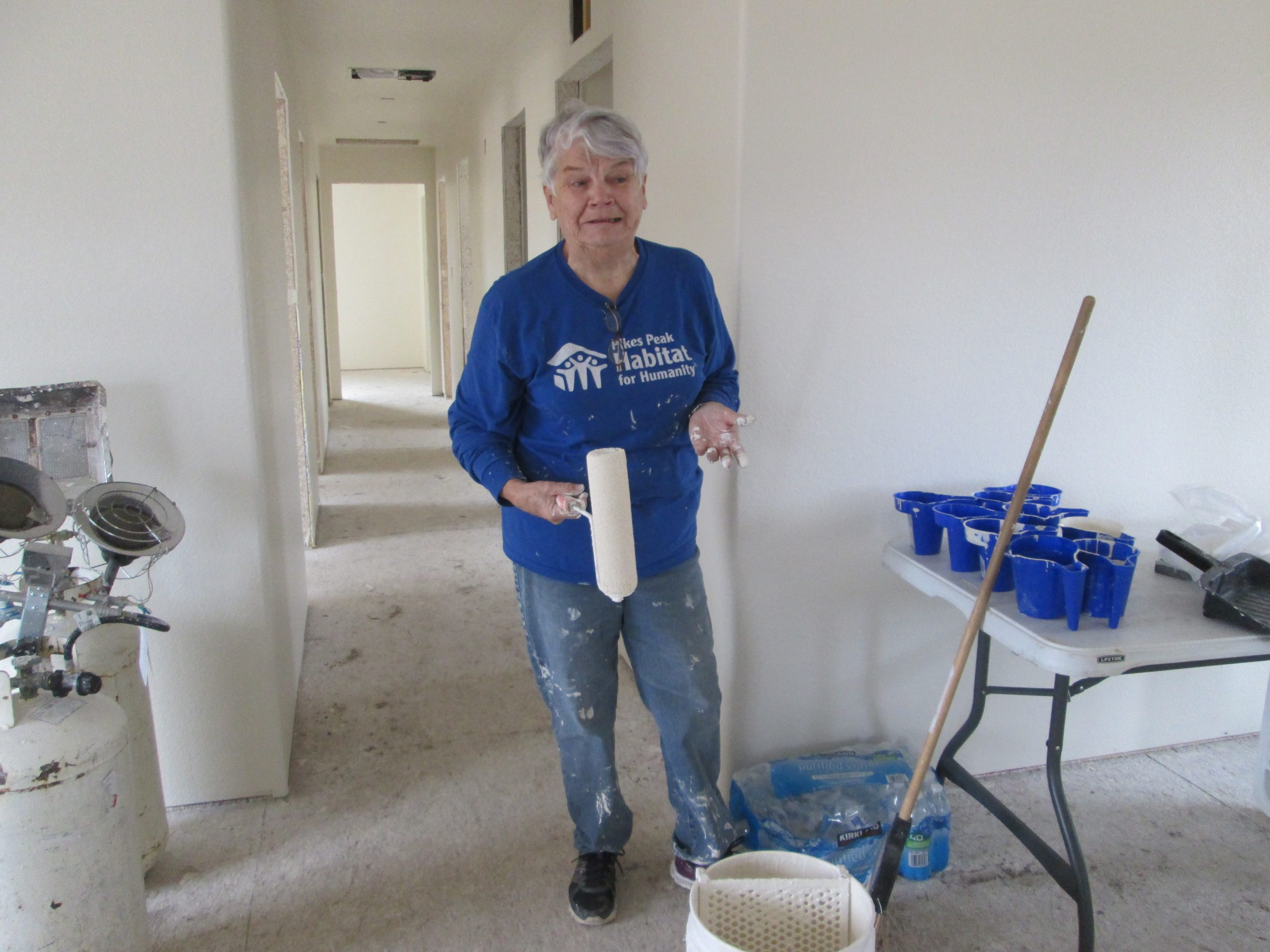 Laurel Thorstensen, board member and long time construction volunteer at Habitat painting Penny's home.