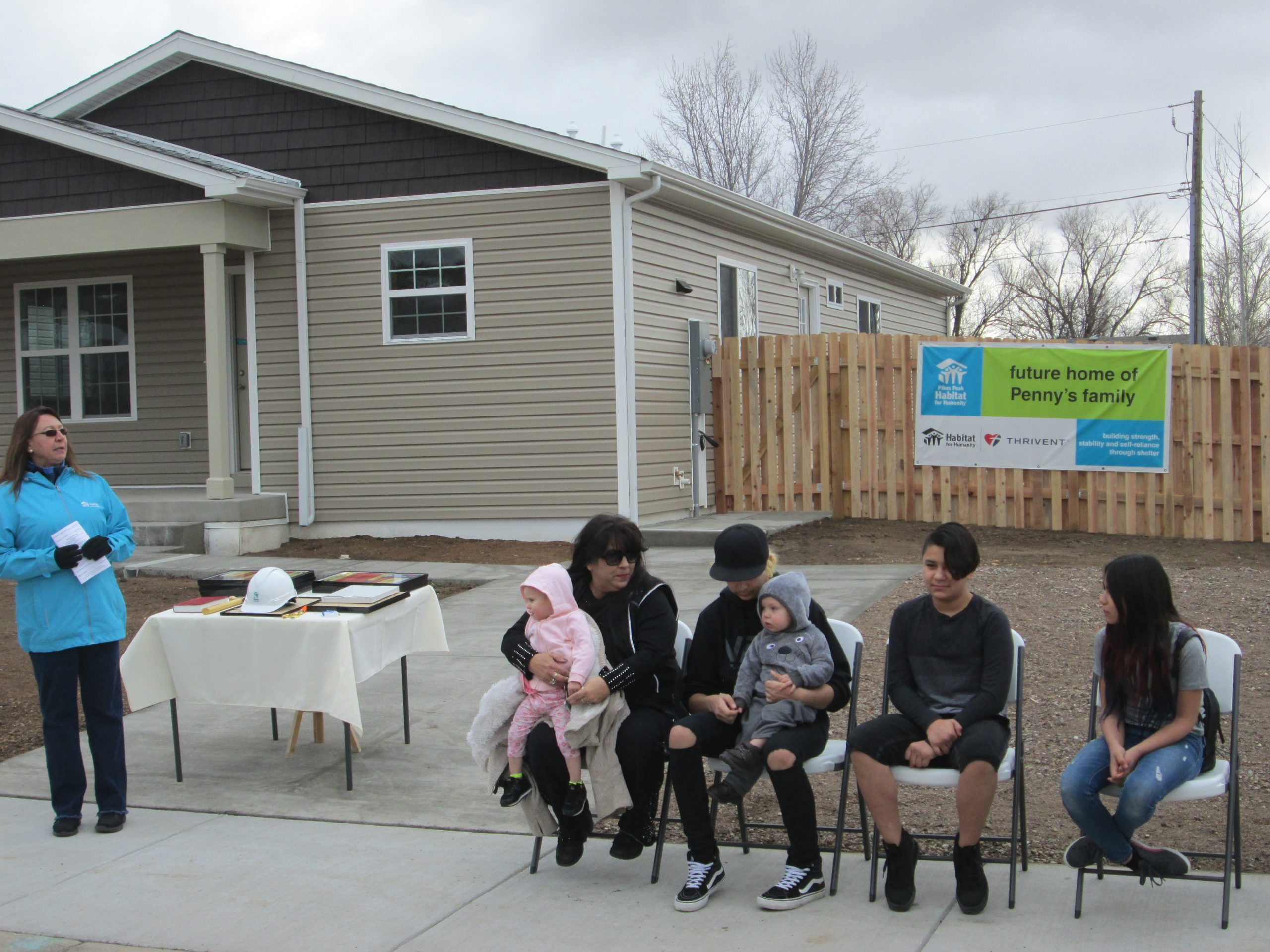 Penny and her family at the home dedication ceremony on January 12, 2019.