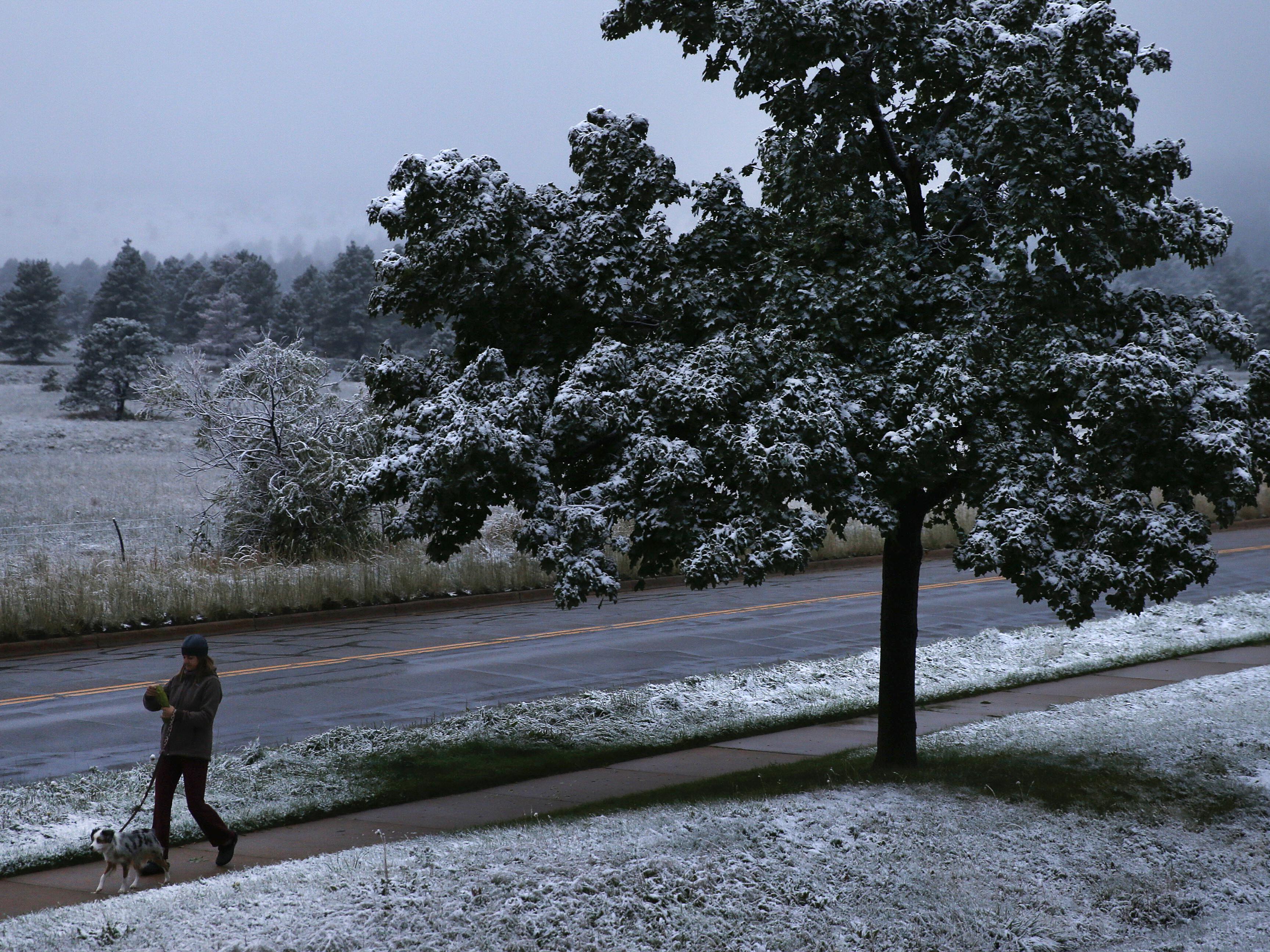 Photo: Boulder snow (AP Photo)