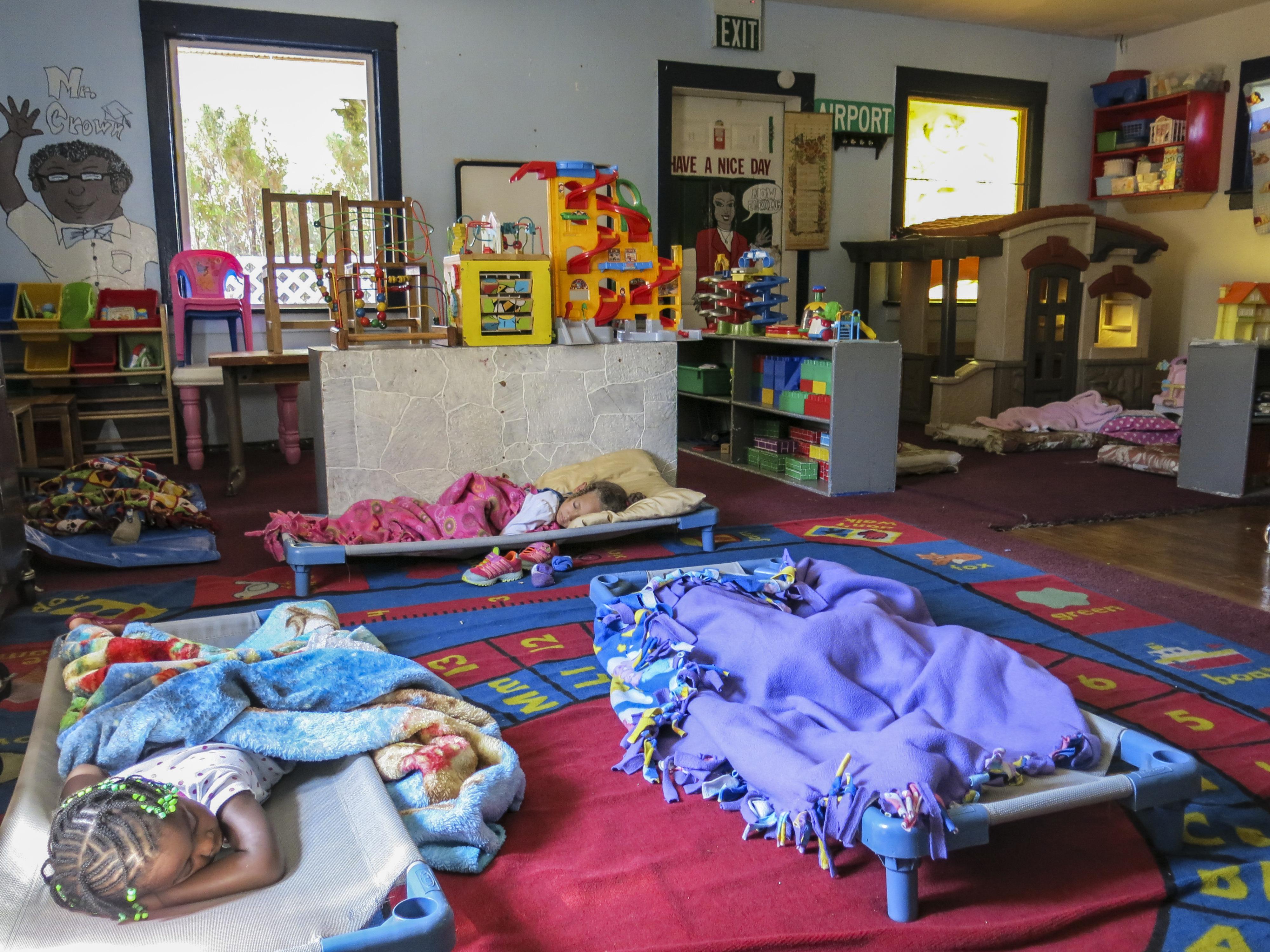 Children take a nap at the Rocky Mountain Public Childcare Center in Aurora, Colo.