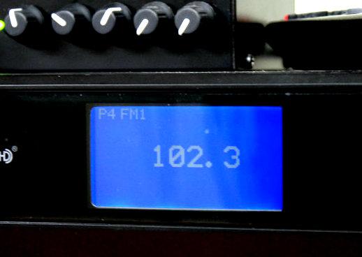 Photo: Radio dial at 102.3 FM