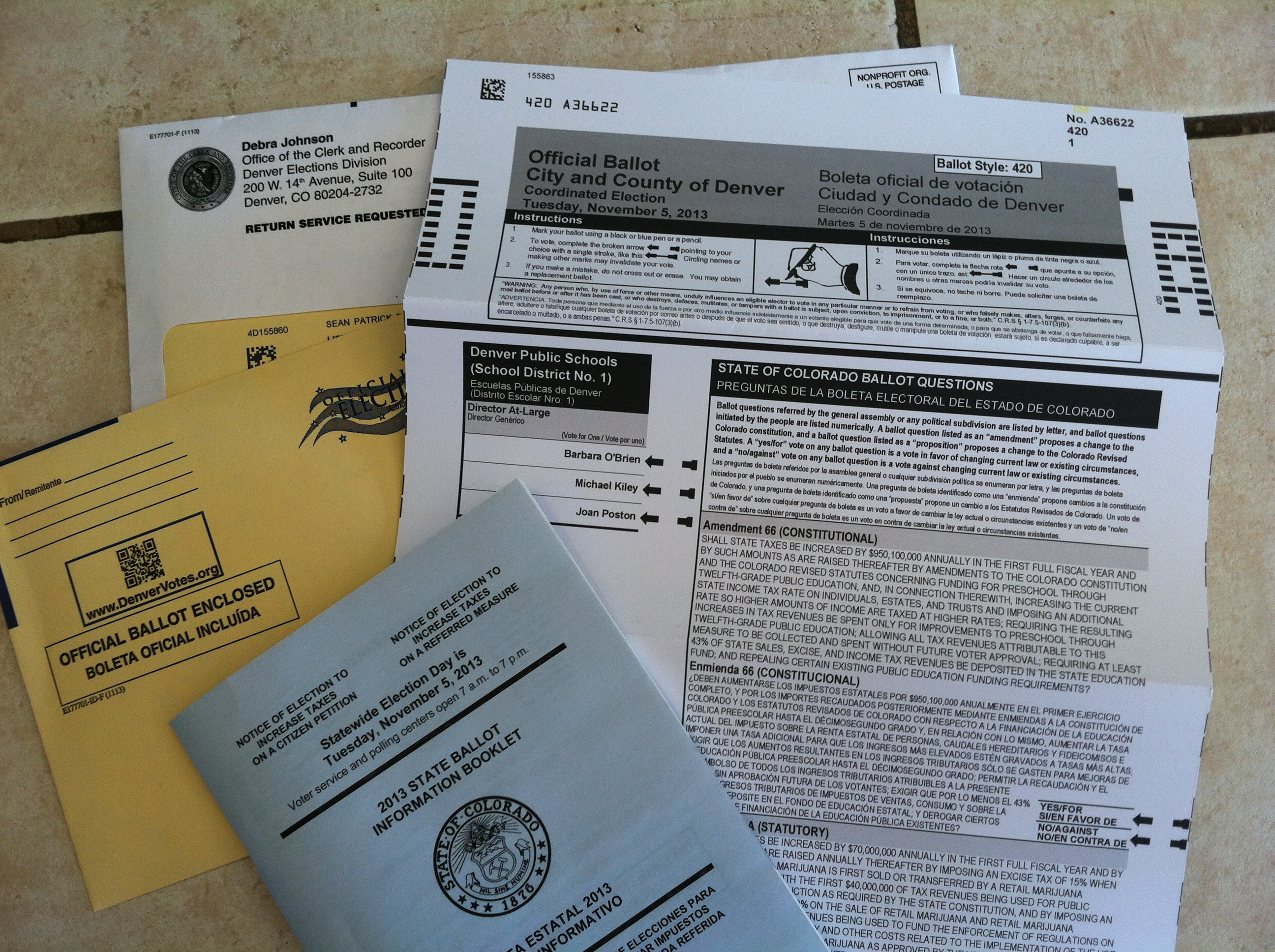 A 2013 ballot and voter blue book.