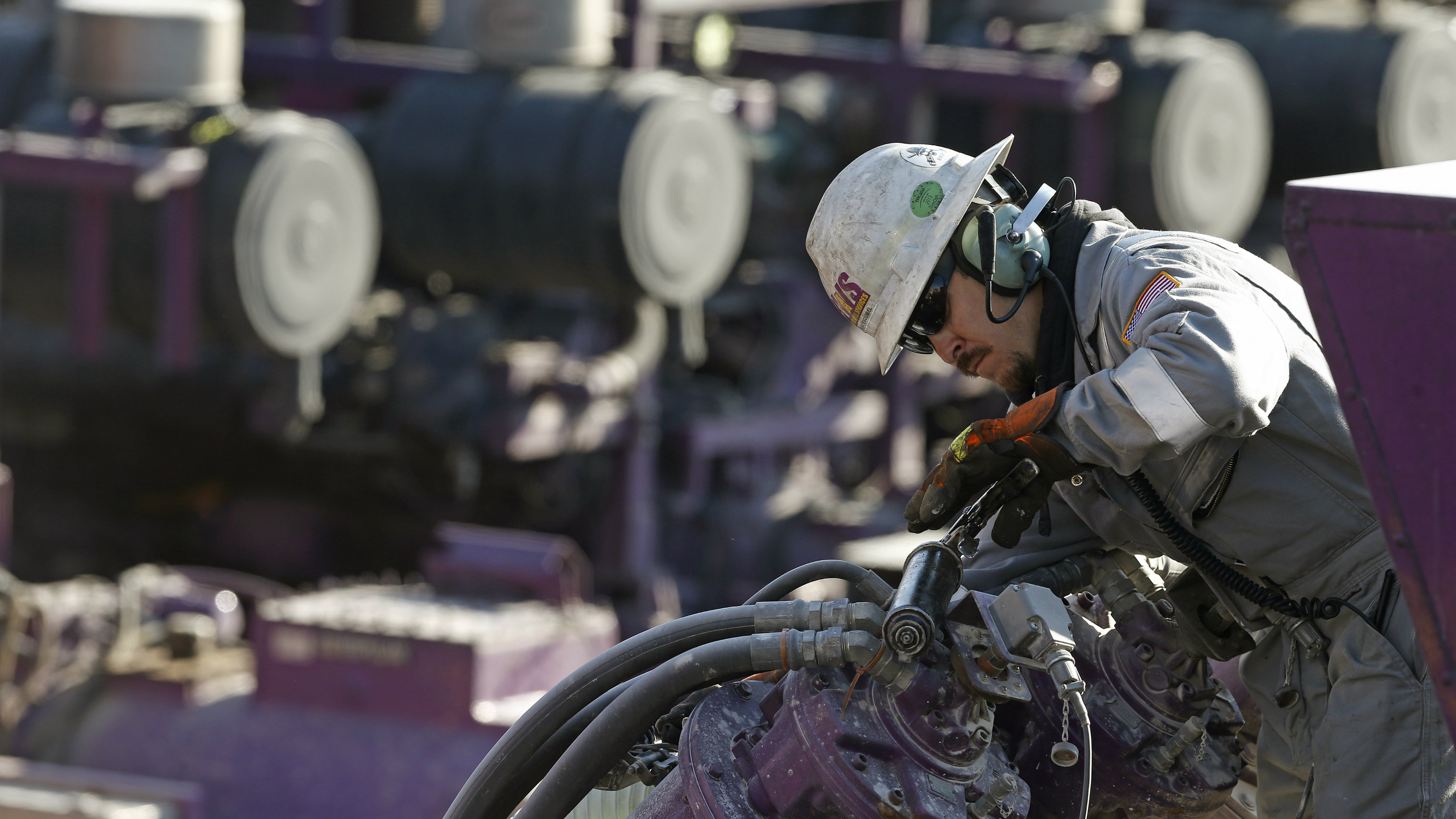 <p>In this March 25, 2014 photo, a worker oils a pump during a hydraulic fracturing operation at an Encana Corp. well pad near Mead, Colo. The National Petroleum Council estimates that up to 80 percent of natural oil wells drilled in the next decade will require hydraulic fracturing.</p>