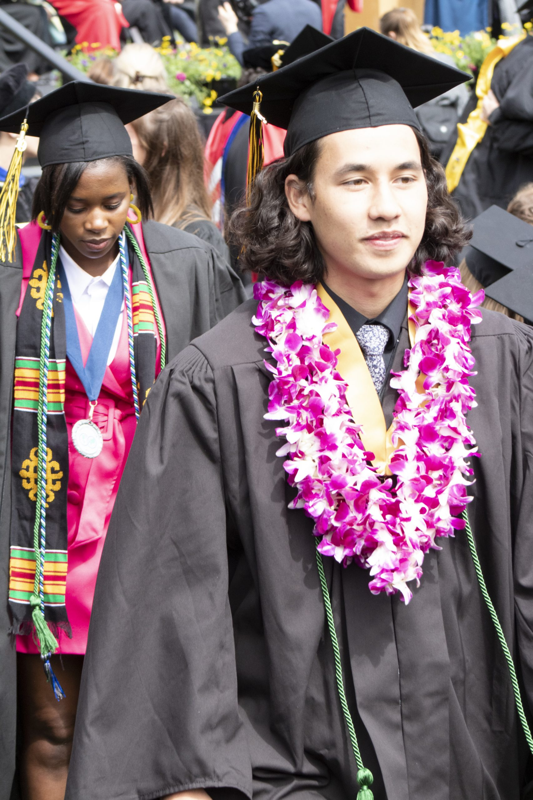 Students make their way back to their seats after recieving their diplomas.