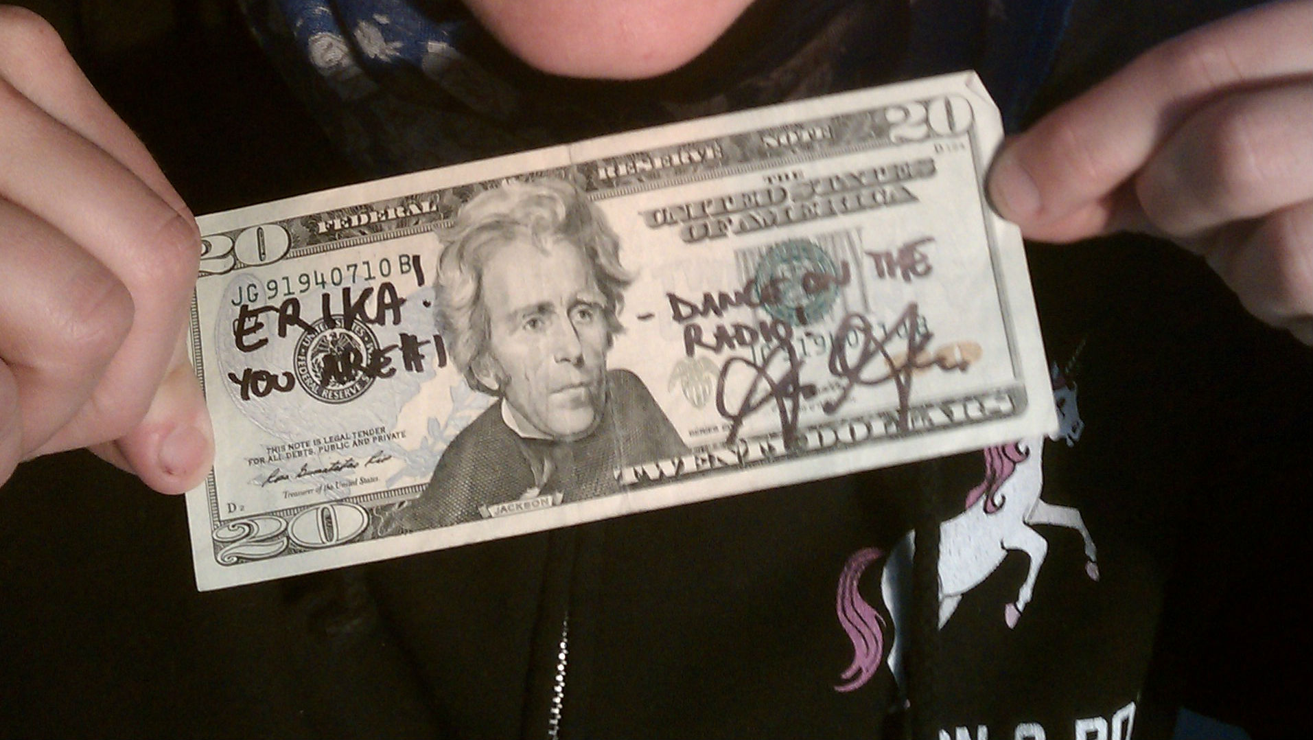 """<p>Ira Glass awarded Erika Randall an autographed $20 bill for her Radio Dance """"Hello, blue soul.""""</p>"""