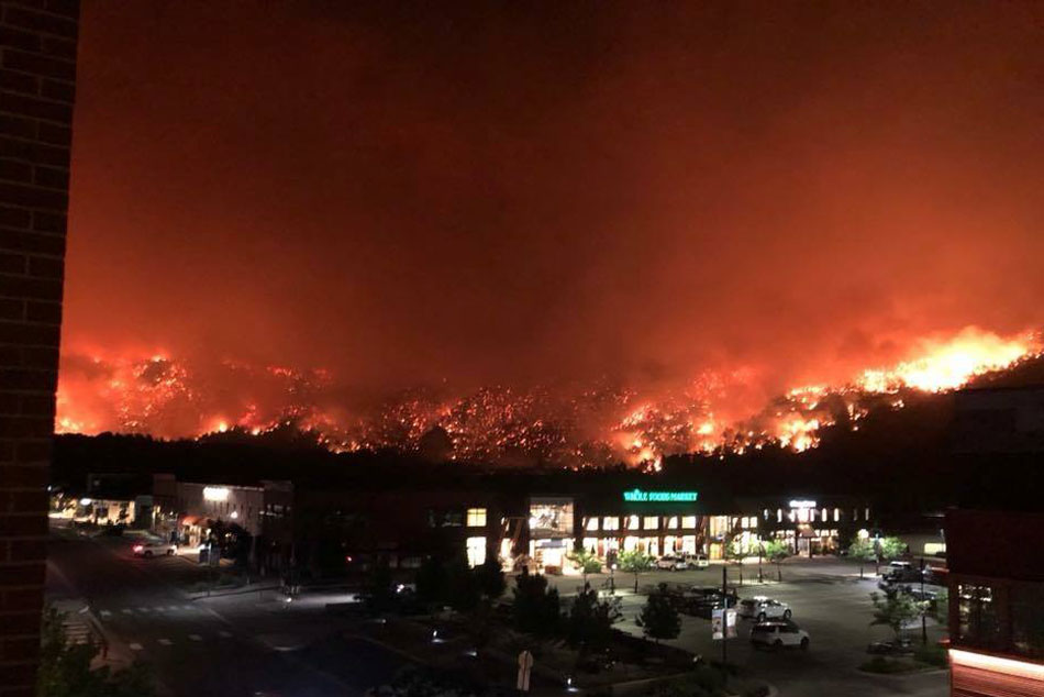 "<p>The western edge of the Lake Christine Fire, near the Whole Foods Market in Basalt. Highway 82, not seen, is just behind the grocery story in the darkness. <span style=""color: rgb(64, 69, 64);"">July 4, 2018</span></p>"