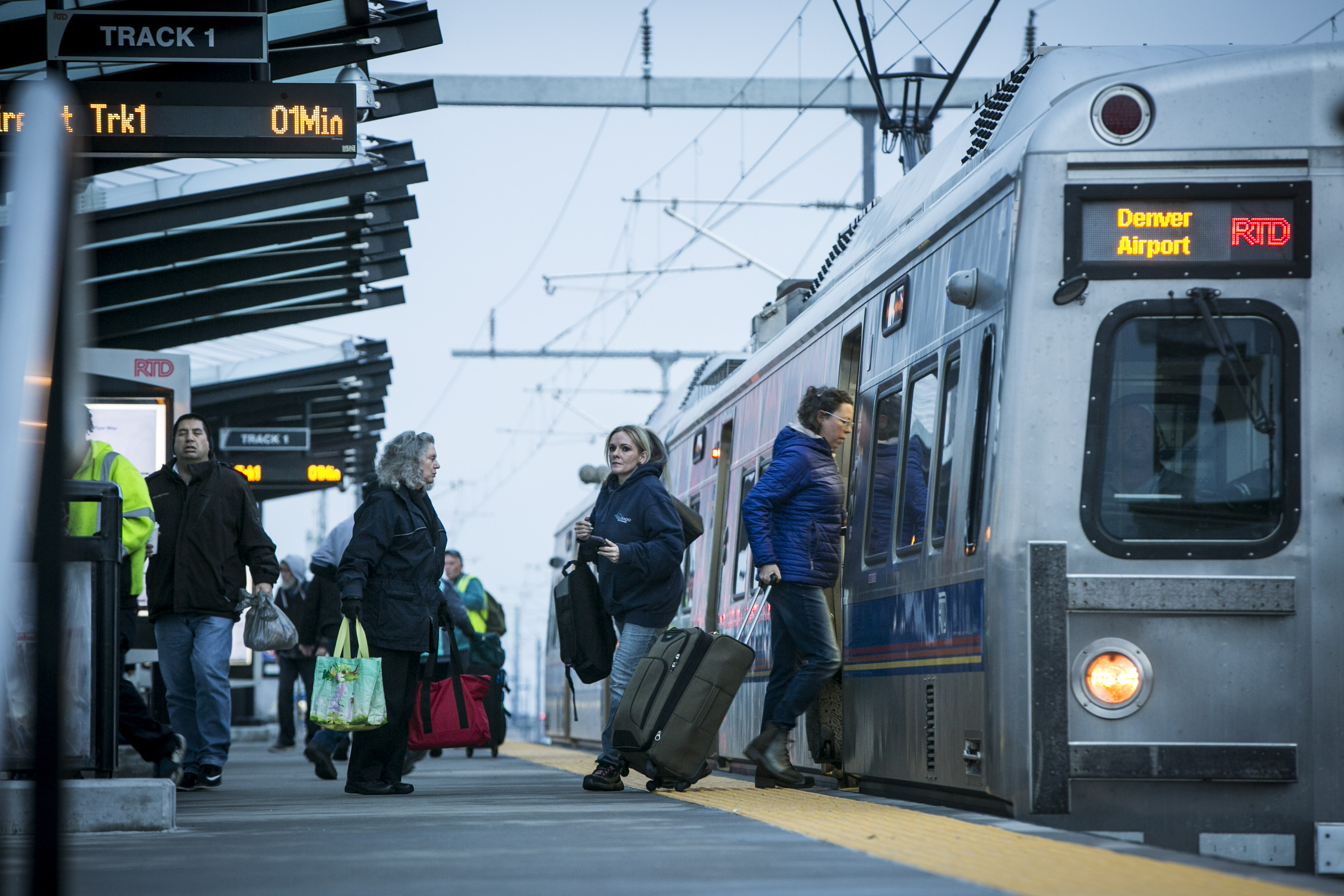 """<p><span style=""""color: rgb(64, 69, 64);"""">Passengers board and leave an A Line train at Central Park station in Denver on Monday, March 26, 2018.</span></p>"""