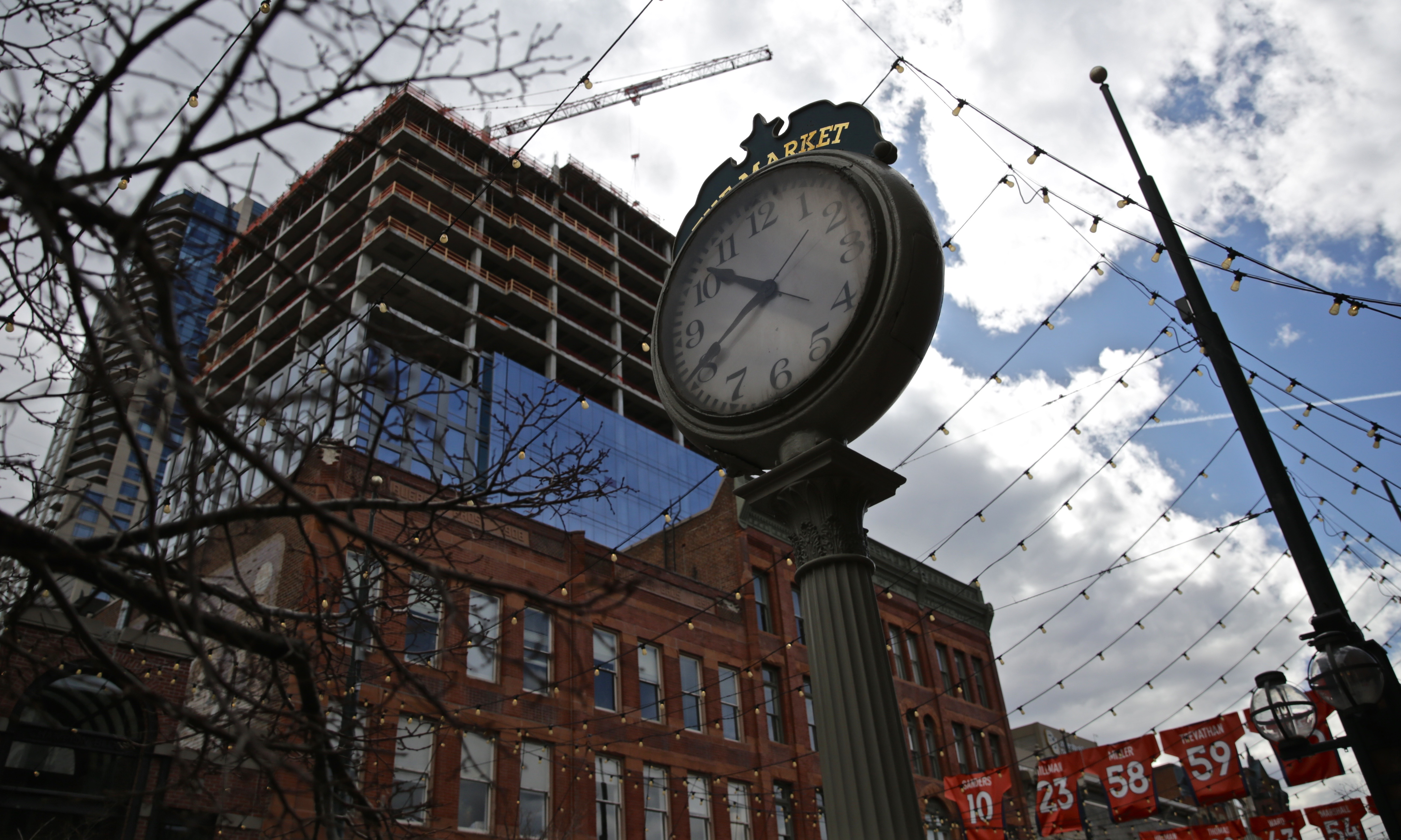 <p>Modern towers rise over the historic buildings in Denver's Larimer Square on Saturday, Feb. 20, 2016.</p>