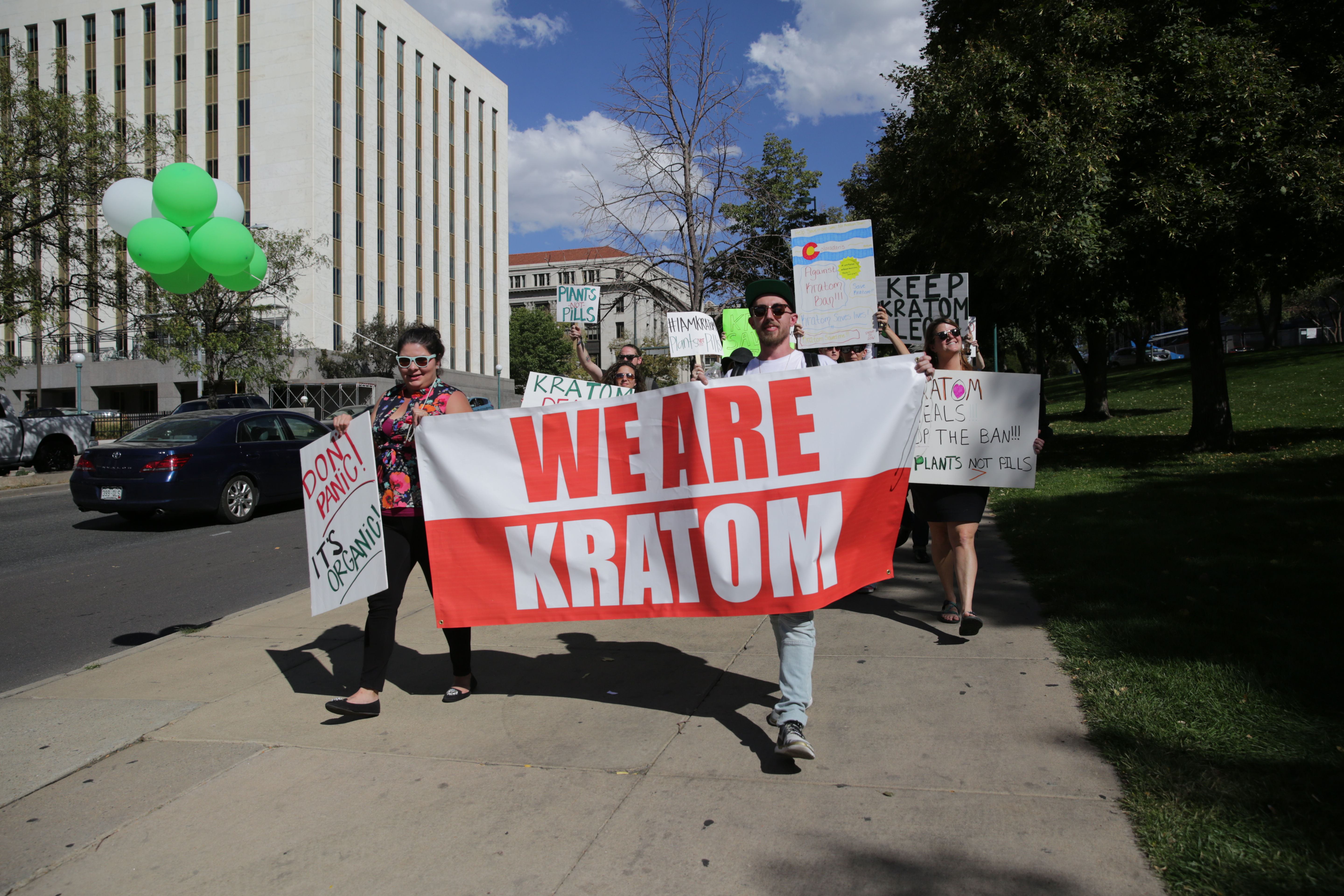 <p>Jeremy Haley, the owner of Rocky Mountain Kratom, marches with supporters at the Denver capital. </p>