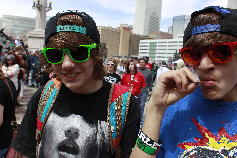 Photo: Youths smoke marijuana, Denver 4/20 rally, Civic Center Park, 2013(AP Photo)