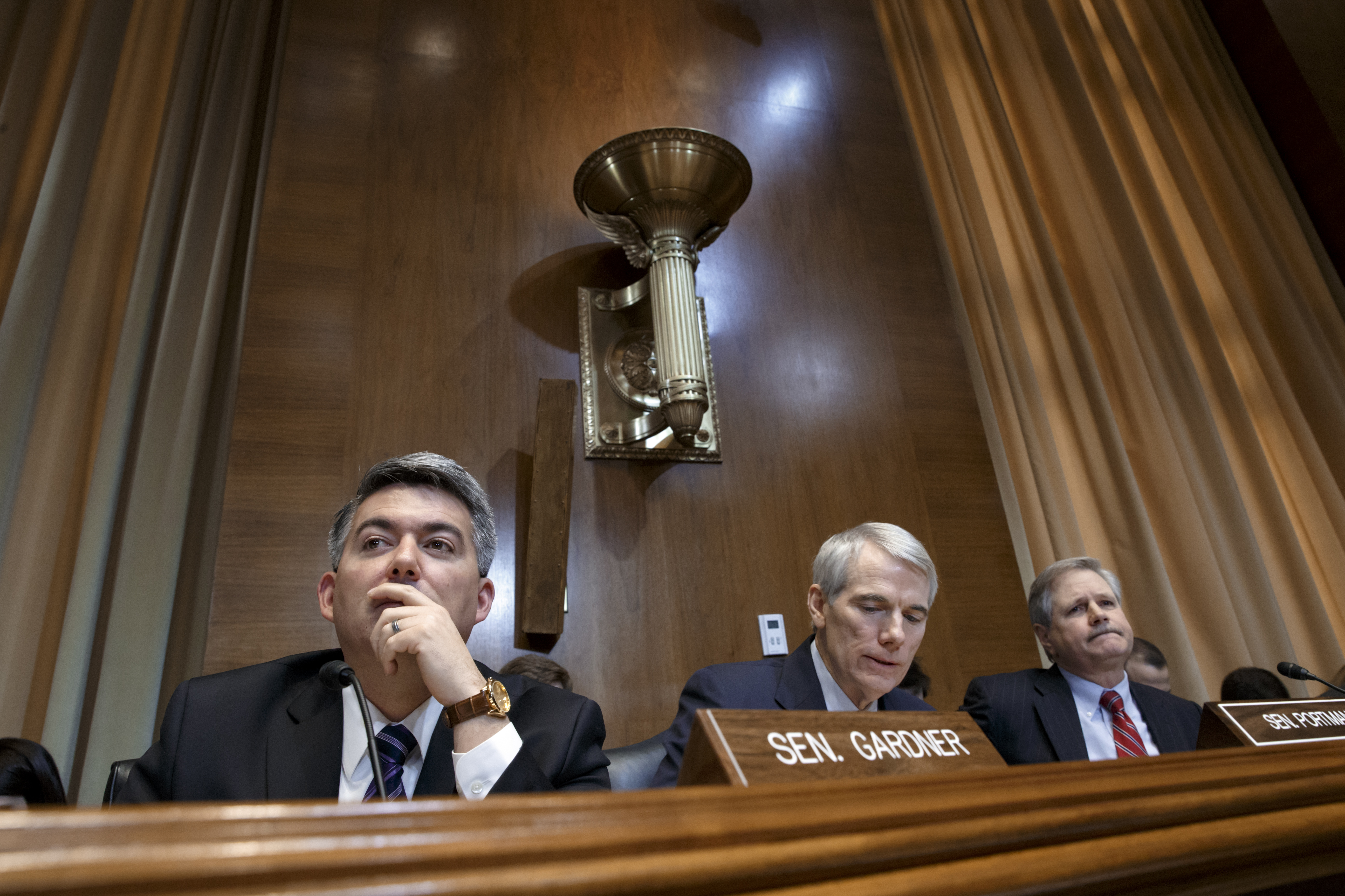<p>From left, Senate Energy and Natural Resources Committee members Sen. Cory Gardner, R-Colo., Sen. Rob Portman, R-Ohio, and Sen. John Hoeven, R-N.D., listen to statements from members of the committee during the markup of the long-stalled Keystone XL pipeline, Jan. 8, 2015, on Capitol Hill in Washington.</p>