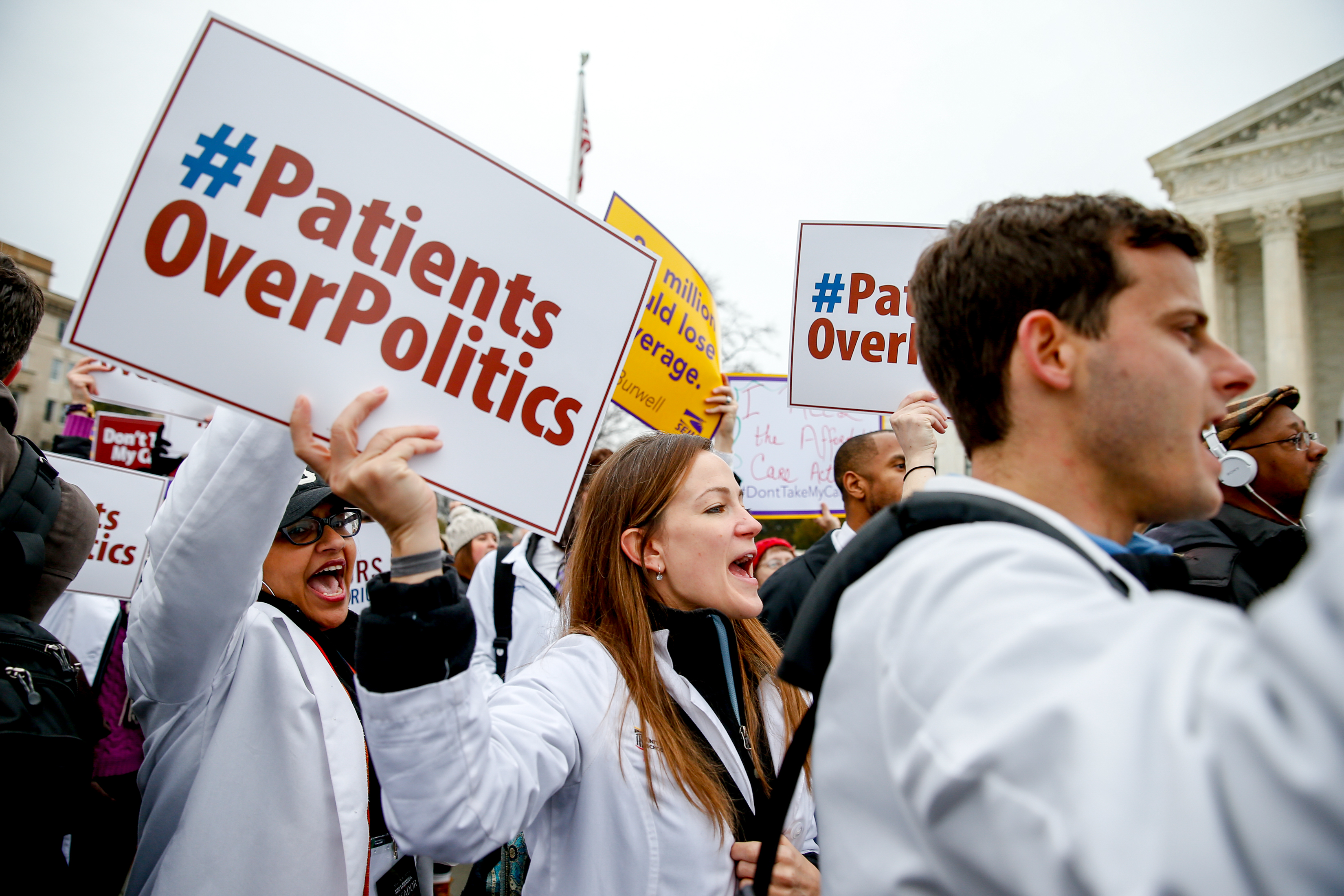 <p>University of Maryland medical student Sarah Britz, center, and others, rally outside the Supreme Court in Washington, Wednesday, March 4, 2015 in Washington, as the court was hearing arguments in King v. Burwell, a major test of President Barack Obama's health overhaul.</p>