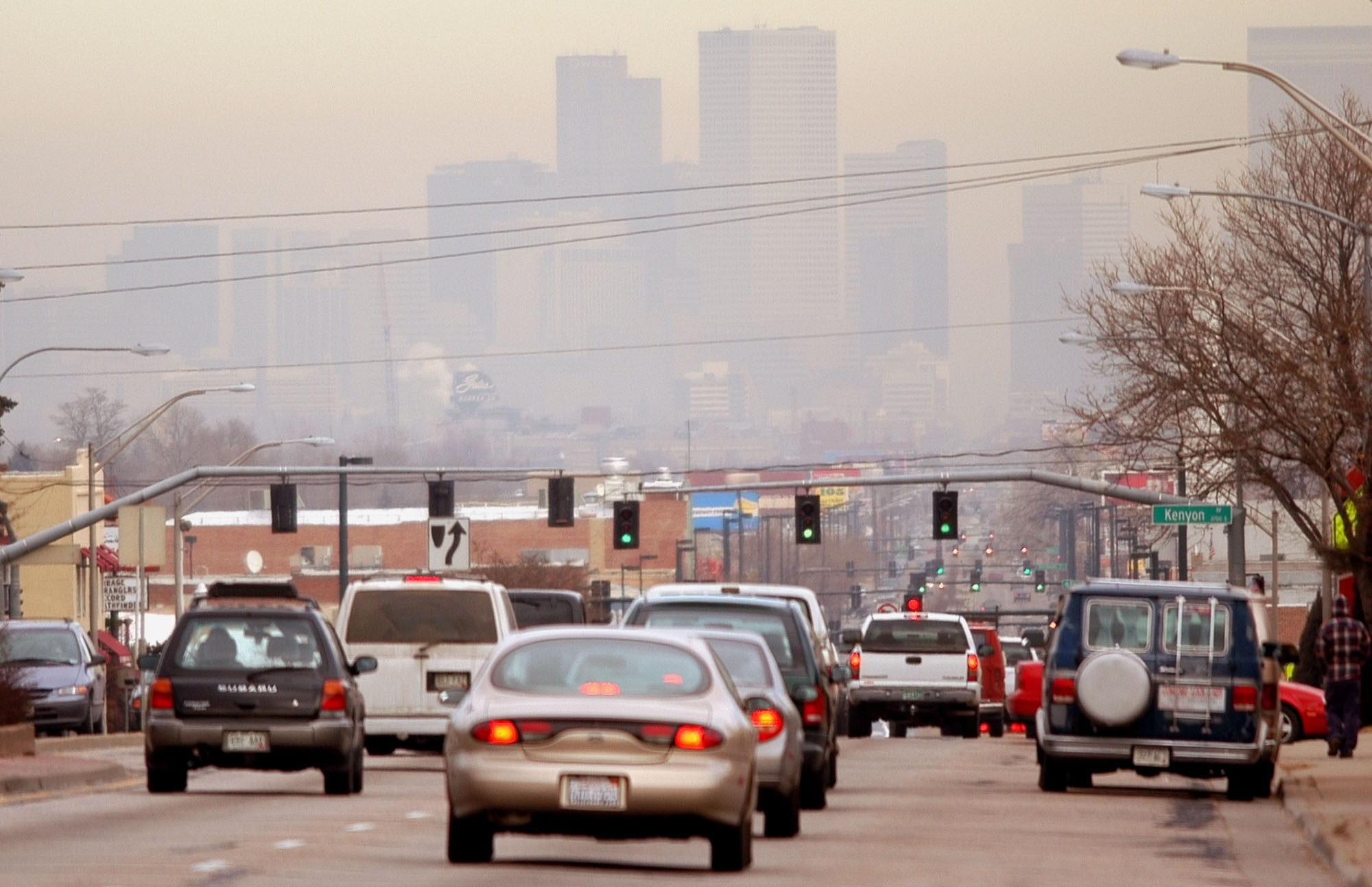 <p>Cars head north toward downtown Denver on South Broadway on a smoggy day in a file photo.</p>