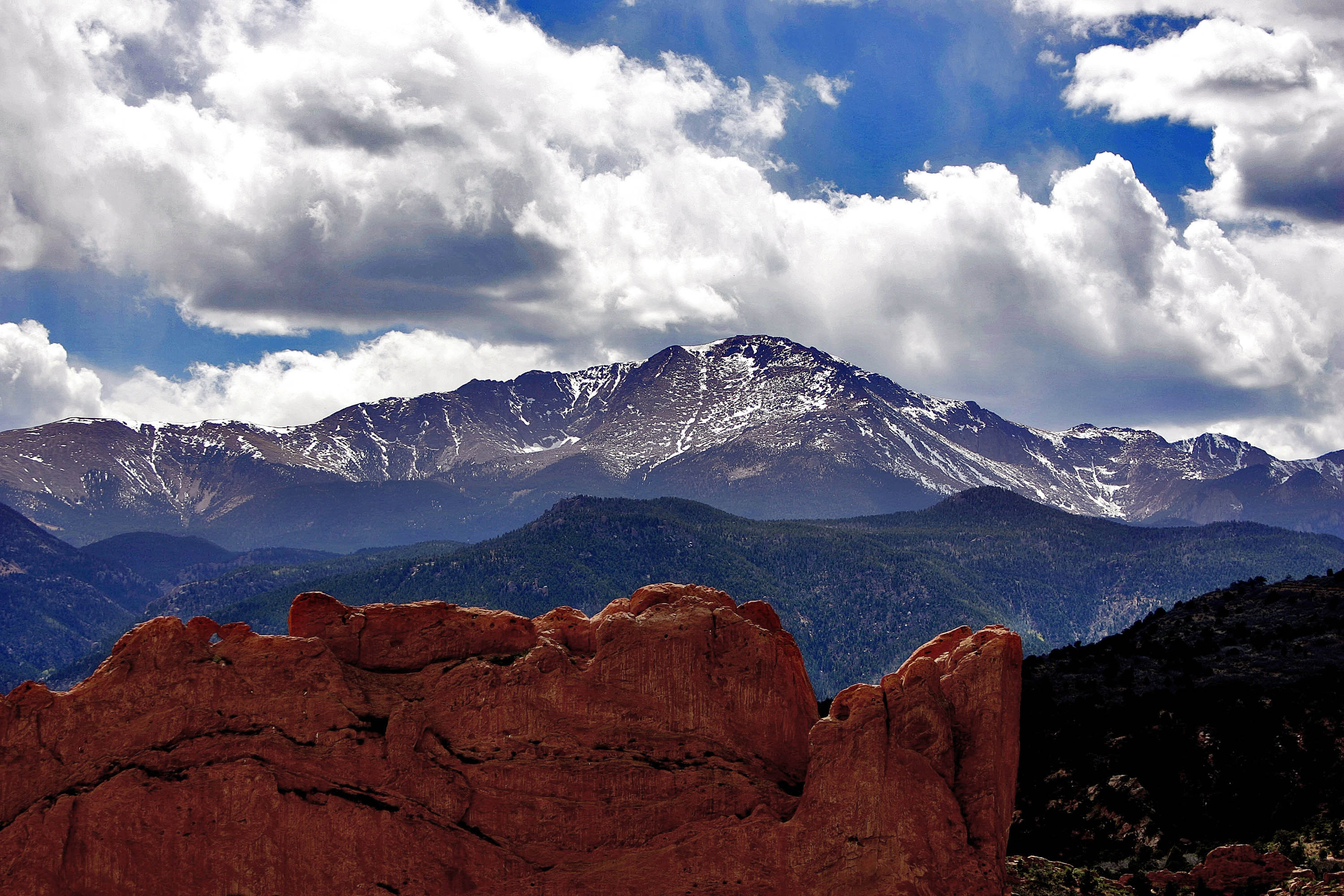 <p>Thesun breaks through the clouds to highlight the summit of Pikes Peak in Colorado Springs.</p>