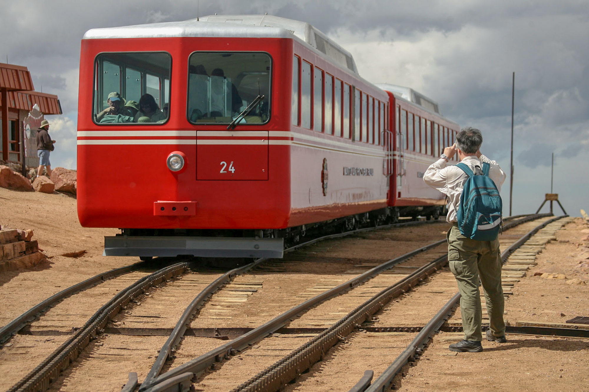 <p>A traveller takes a photograph of the Manitou and Pike's Peak Cog Railway train at the summit of Pike's Peak, May 2006.</p>