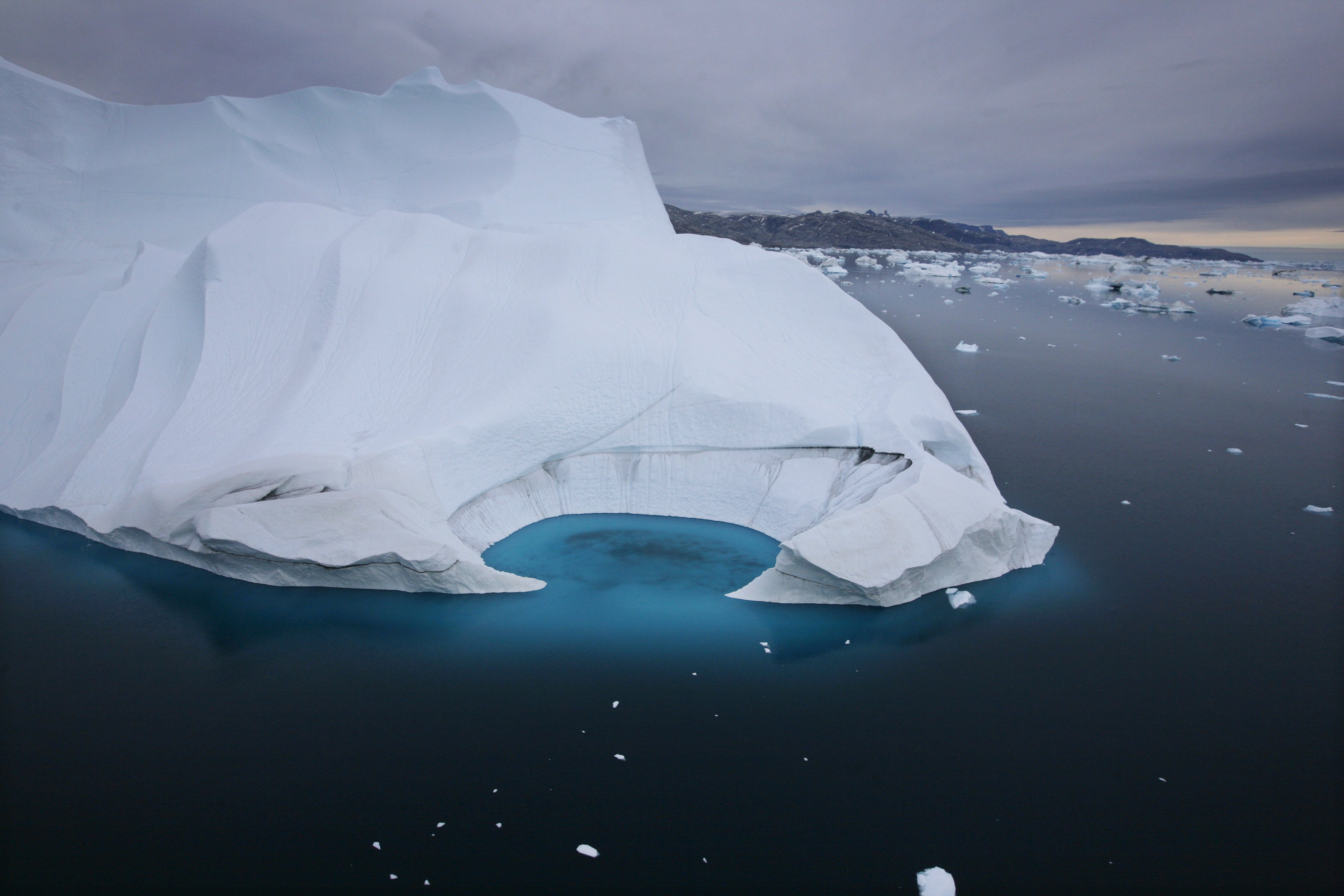 <p>In this 2007 file photo, an iceberg is seen melting off the coast of Ammasalik, Greenland.</p>
