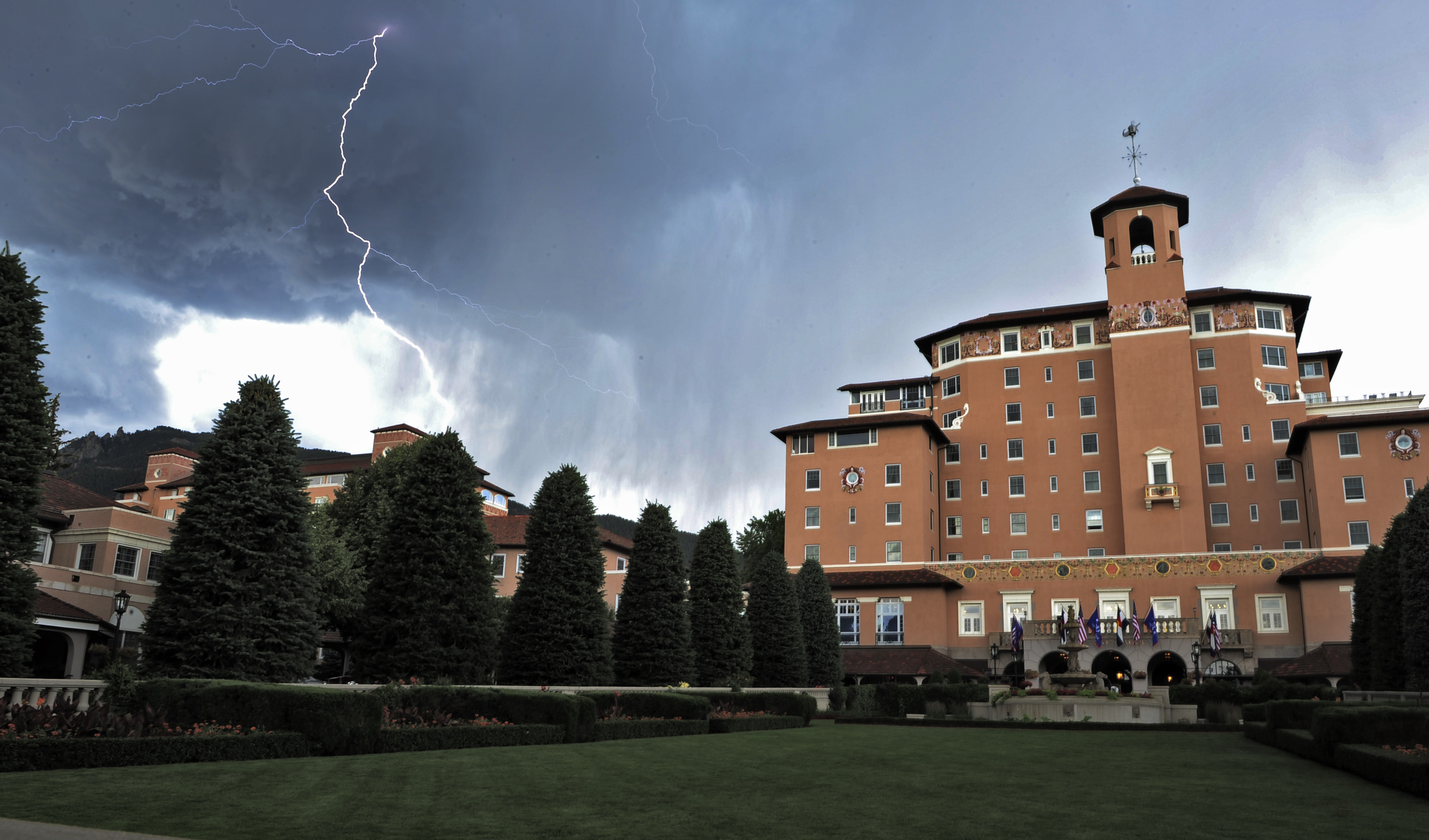 <p>Lightning flashes in the sky over the Broadmoor Hotel during the third round of the Women's U.S. Open golf tournamenton July 9, 2011, in Colorado Springs, Colo.</p>