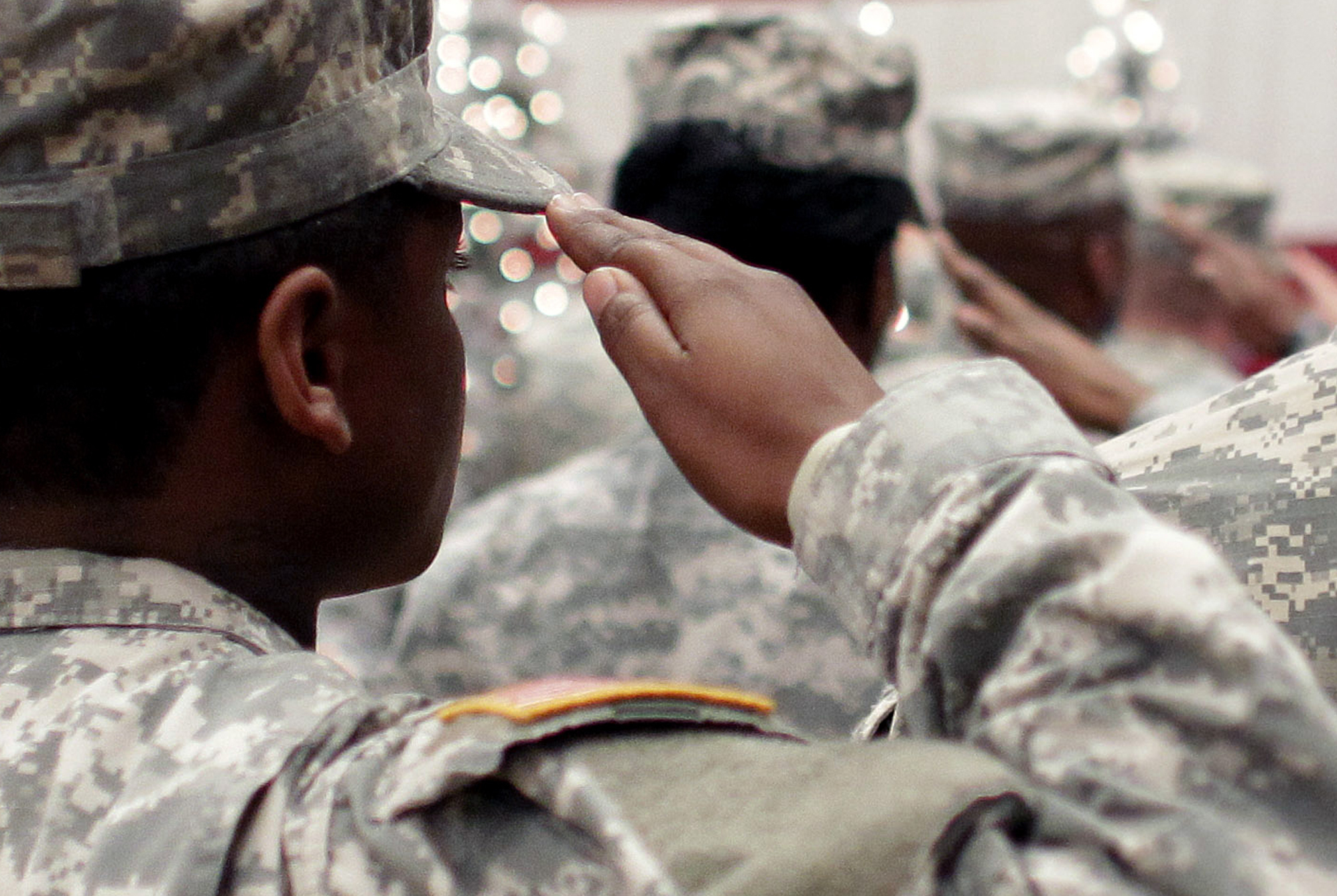 <p>In this Wednesday Dec. 5, 2012, file photo, soldiers salute the U.S. flag during the Pledge of Allegiance at a welcome home ceremony for soldiers returning from a deployment in Afghanistan, at Fort. Carson, Colo.</p>