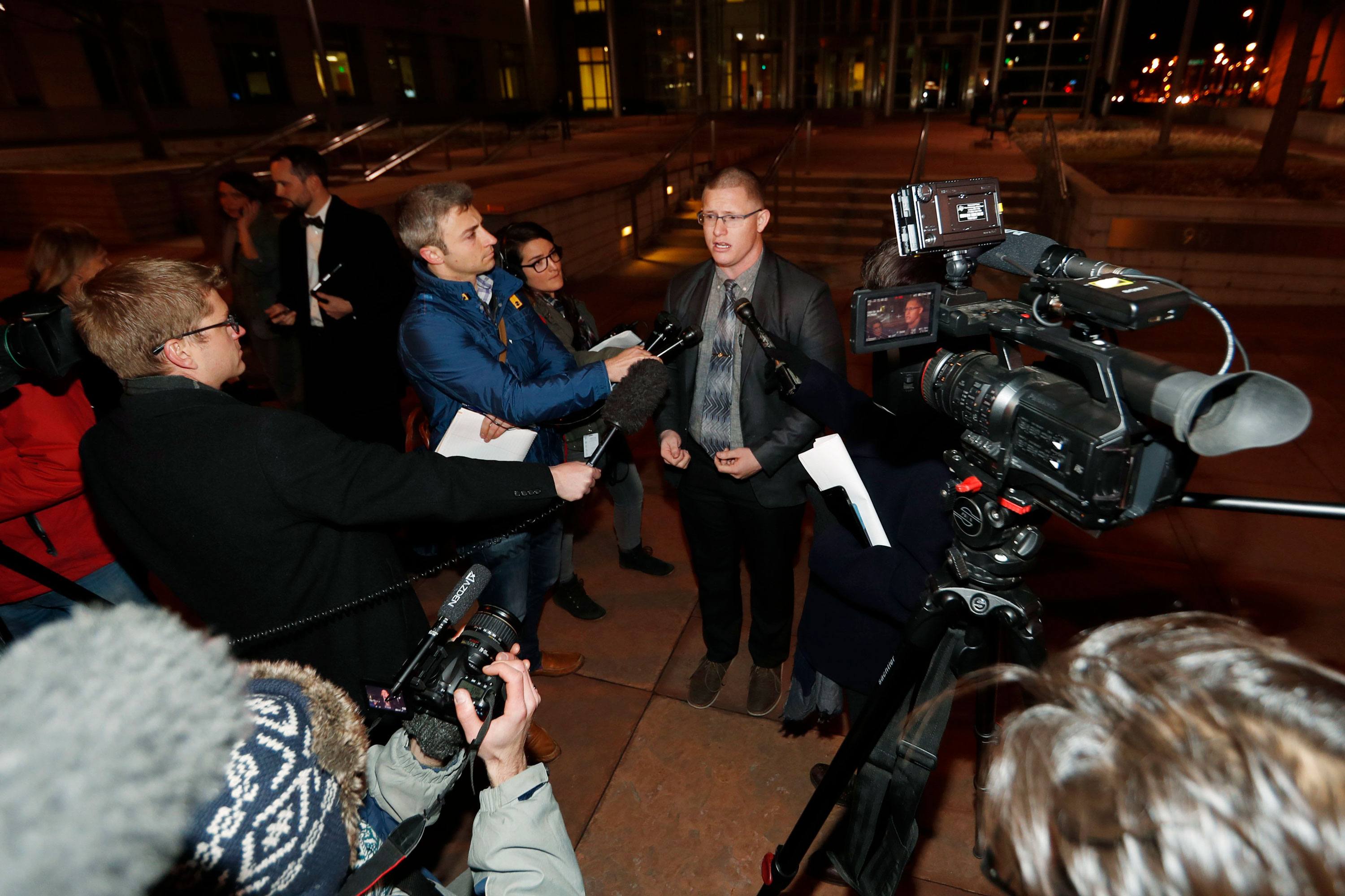 Micheal Baca, center, speaks after arguments in a lawsuit were heard Dec. 12, 2016, outside the federal courthouse in downtown Denver. The suit had sought to free Colorado's electors of the requirement that they vote for the winner of the state's popular vote in the presidential election.